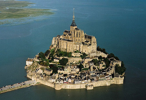 Mont Saint-Michel, located one kilometre off France's northwestern coast, at the mouth of the Couesnon River near Avranches, Normandy, France - www.castlesandmanorhouses.com